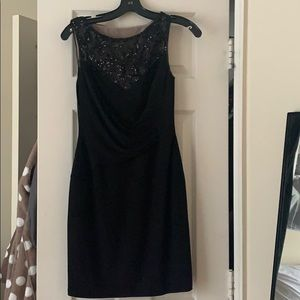 Glittery tight black dress
